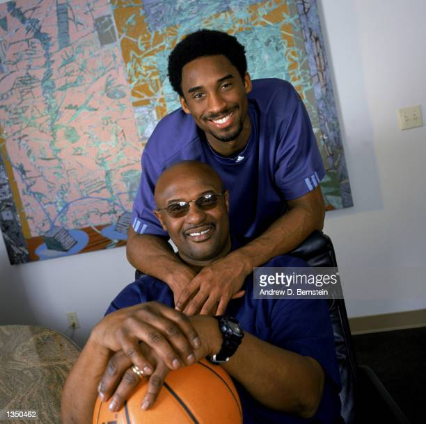 Guard Kobe Bryant of the Los Angeles Lakers poses for a portrait with his father former NBA player Joe 'Jellybean' Bryant after purchasing a 50...