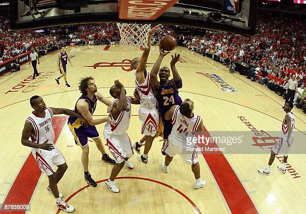 Guard Kobe Bryant of the Los Angeles Lakers takes a shot against Shane Battier of the Houston Rockets in Game Six of the Western Conference...