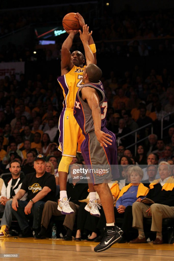 Guard <a gi-track='captionPersonalityLinkClicked' href=/galleries/search?phrase=Kobe+Bryant&family=editorial&specificpeople=201466 ng-click='$event.stopPropagation()'>Kobe Bryant</a> #24 of the Los Angeles Lakers takes a shot against <a gi-track='captionPersonalityLinkClicked' href=/galleries/search?phrase=Grant+Hill+-+Basketball+Player&family=editorial&specificpeople=201658 ng-click='$event.stopPropagation()'>Grant Hill</a> #33 of the Phoenix Suns in Game One of the Western Conference Finals during the 2010 NBA Playoffs at Staples Center on May 17, 2010 in Los Angeles, California.