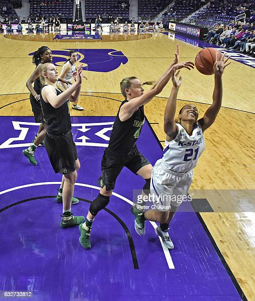 Guard Kristy Wallace of the Baylor Bears blocks the shot attempt of guard Karyla Middlebrook of the Kansas State Wildcats during the first half on...