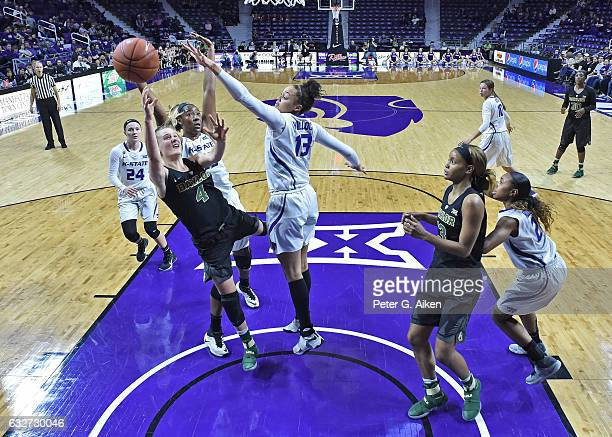 Guard Kristy Wallace of the Baylor Bears puts up a shot against forward Eternati Willock of the Kansas State Wildcats during the second half on...