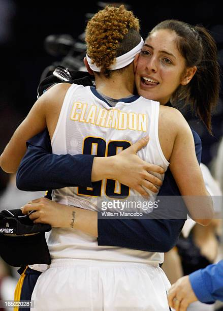 Guard Layshia Clarendon of the California Golden Bears celebrates with a friend after the game against the Georgia Lady Bulldogs during the NCAA...