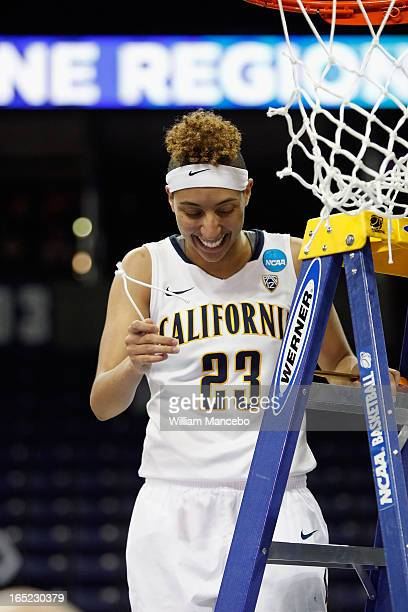 Guard Layshia Clarendon of the California Golden Bears cuts off a piece of the net after the game against the Georgia Lady Bulldogs during the NCAA...