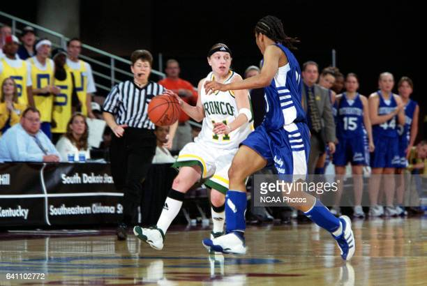 Guard Leah Whatley of Cal Poly Pomona drives down court with guard Natalie Wimbley of Southeastern Oklahoma State University during the NCAA Division...