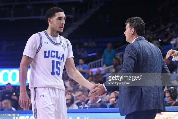 UCLA guard LiAngelo Ball gets a high five from UCLA head coach Steve Alford during an college exhibition basketball game between the Cal State Los...