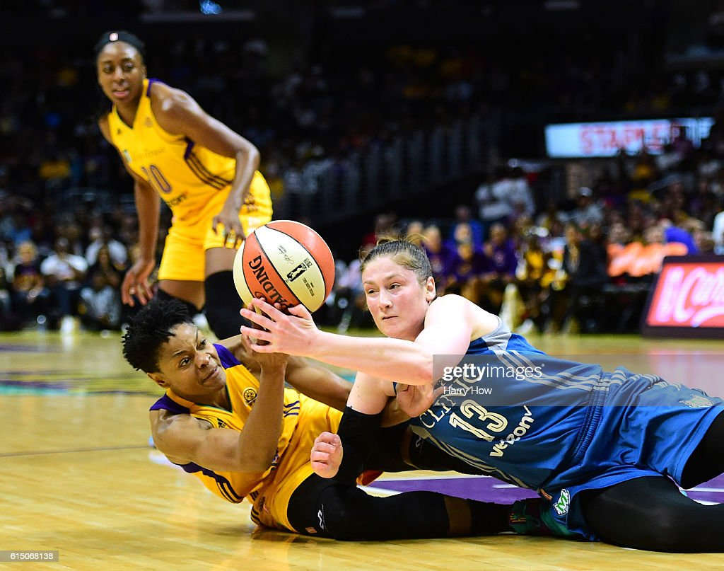 Guard Lindsay Whalen #13 of the Minnesota Lynx and guard Alana Beard #0 of the Los Angeles Sparks dive for a ball in front of forward Nneka Ogwumike #30 at Staples Center on October 16, 2016 in Los Angeles, California.