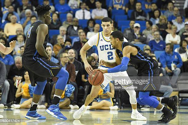 UCLA guard Lonzo Ball guards UCSB guard Eric Childress during an NCAA basketball game between the UC Santa Barbara Gauchos and the UCLA Bruins on...