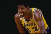Guard Magic Johnson of the Los Angeles Lakers stands on the court during a game at the Great Western Forum in Inglewood California