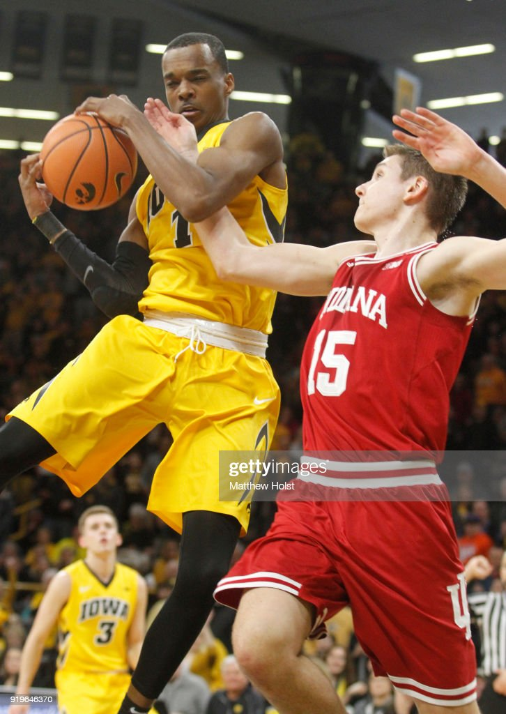 Guard Maishe Dailey #1 of the Iowa Hawkeyes grabs a rebound during the second half against guard Zach McRoberts #15 of the Indiana Hoosiers on February 17, 2018 at Carver-Hawkeye Arena, in Iowa City, Iowa.