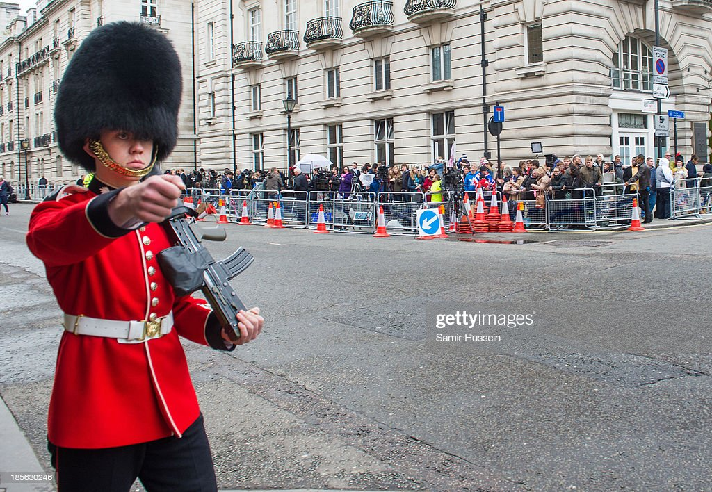 A guard marches as crowds gather outside St James' Palace ahead of the christening of HRH Prince George of Cambridge on October 23, 2013 in London, England.
