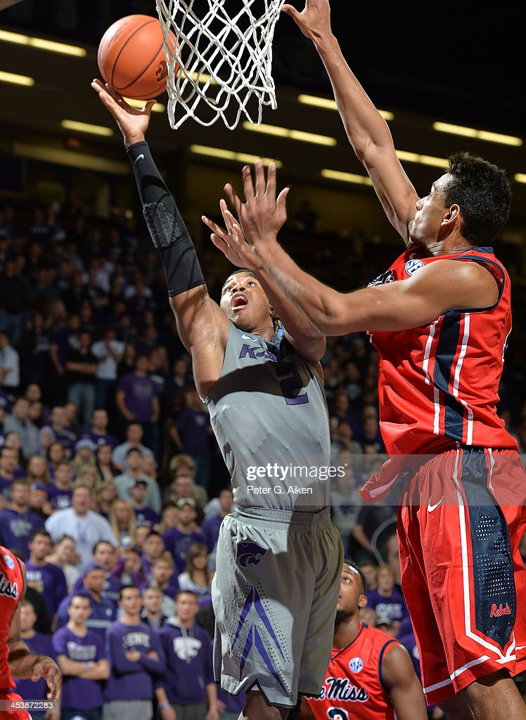 Guard Marcus Foster #2 of the Kansas State Wildcats drives to the basket against forward Anthony Perez #13 of the Mississippi Rebels during the second half on December 5, 2013 at Bramlage Coliseum in Manhattan, Kansas. Kansas State won 61-58.