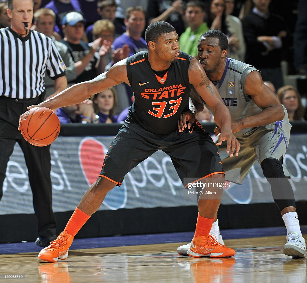 Guard Marcus Smart #33 of the Oklahoma State Cowboys drives against guard Martavious Irving #3 of the Kansas State Wildcats during the second half on January 5, 2013 at Bramlage Coliseum in Manhattan, Kansas.