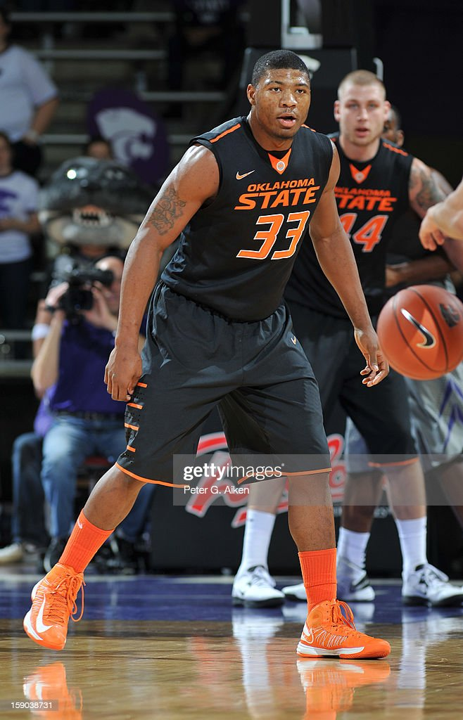 Guard Marcus Smart #33 of the Oklahoma State Cowboys gets set on defense against the Kansas State Wildcats during the second half on January 5, 2013 at Bramlage Coliseum in Manhattan, Kansas.