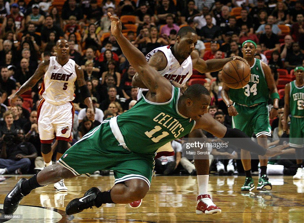 Guard Mario Chalmers #6 of the Miami Heat drives against Center <a gi-track='captionPersonalityLinkClicked' href=/galleries/search?phrase=Glen+Davis+-+Basketball+Player&family=editorial&specificpeople=709385 ng-click='$event.stopPropagation()'>Glen Davis</a> #11 of the Boston Celtics in Game Four of the Eastern Conference Quarterfinals during the 2010 NBA Playoffs at American Airlines Arena on April 25, 2010 in Miami, Florida.
