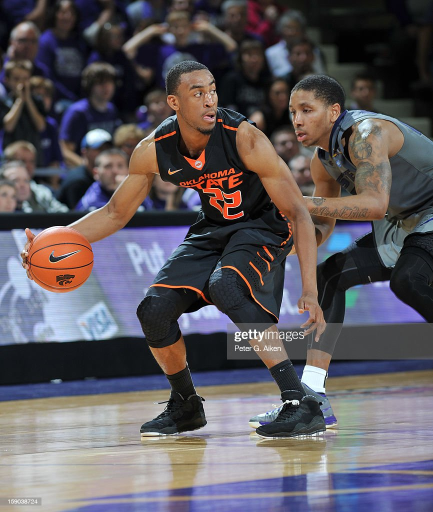 Guard Markel Brown (L) of the Oklahoma State Cowboys drives against guard Rodney McGruder (R) of the Kansas State Wildcats during the second half on January 5, 2013 at Bramlage Coliseum in Manhattan, Kansas.
