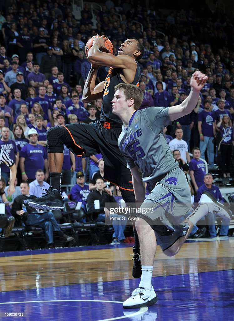 Guard Markel Brown (22) of the Oklahoma State Cowboys drives to the basket against guard Will Spradling (55) of the Kansas State Wildcats during the first half on January 5, 2013 at Bramlage Coliseum in Manhattan, Kansas.