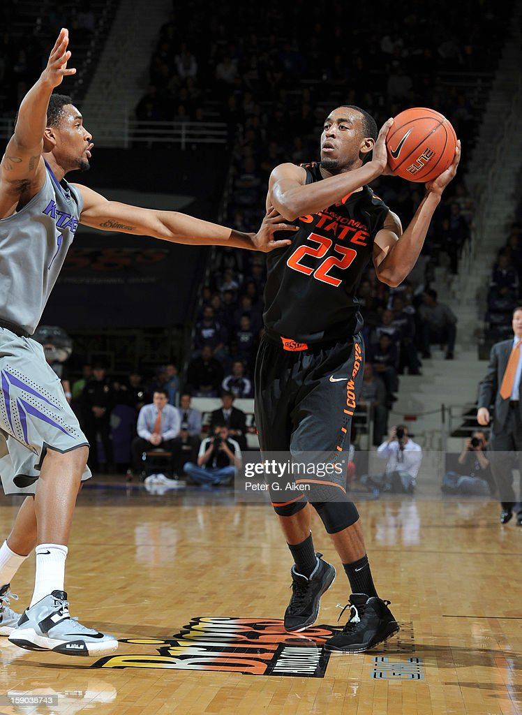 Guard Markel Brown (22) of the Oklahoma State Cowboys makes a pass against guard Shane Southwell (1) of the Kansas State Wildcats during the first half on January 5, 2013 at Bramlage Coliseum in Manhattan, Kansas.