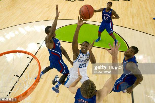 Guard Marquis Teague from the University of Kentucky puts up a shot attempt in front of center Jeff Withey guard Tyshawn Taylor and forward Thomas...