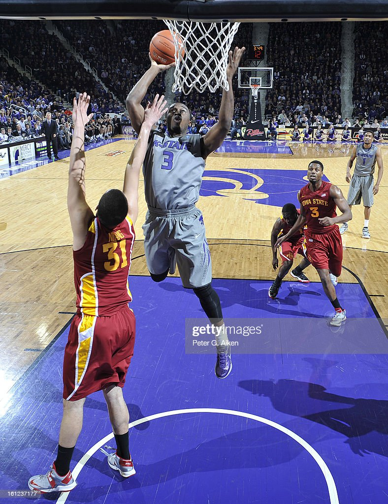 Guard Martavious Irving #3 of the Kansas State Wildcats drives to the basket against forward Georges Niang #31 of the Iowa State Cyclones during the first half on February 9, 2013 at Bramlage Coliseum in Manhattan, Kansas. Kansas State defeated Iowa State 79-70.
