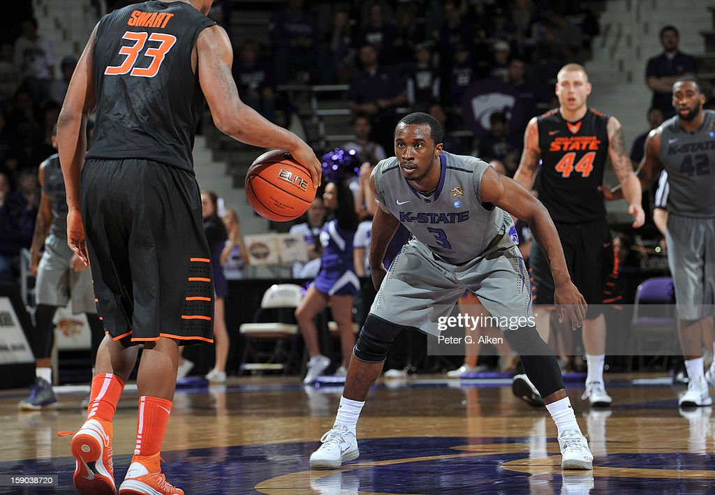 Guard Martavious Irving #3 of the Kansas State Wildcats gets set on defense against the Oklahoma State Cowboys during the second half on January 5, 2013 at Bramlage Coliseum in Manhattan, Kansas.