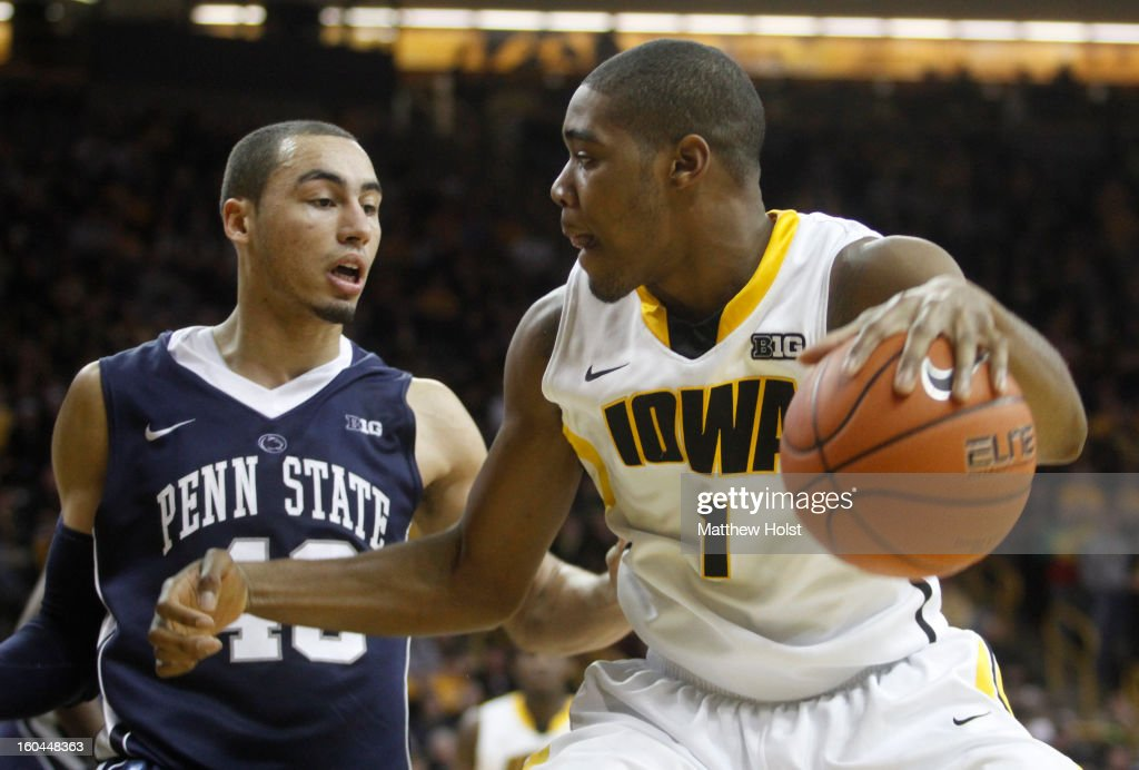 Guard Melsahn Basabe #1 of the Iowa Hawkeyes drives to the basket during the second half in front of forward Travis Ross #43 of the Penn State Nittany Lions on January 31, 2013 at Carver-Hawkeye Arena in Iowa City, Iowa.