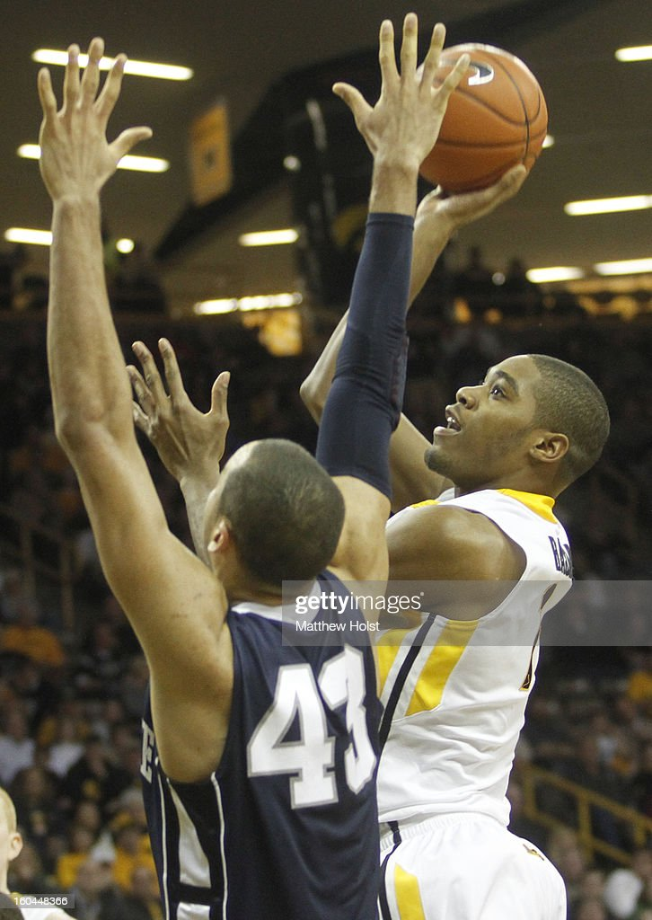 Guard Melsahn Basabe #1 of the Iowa Hawkeyes takes a shot during the second half in front of forward Travis Ross #43 of the Penn State Nittany Lions on January 31, 2013 at Carver-Hawkeye Arena in Iowa City, Iowa.