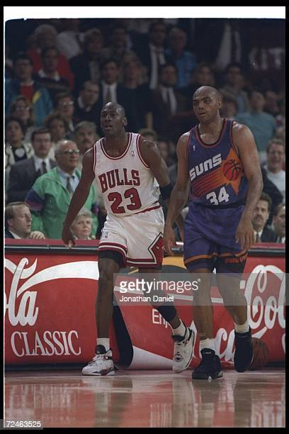 Guard Michael Jordan of the Chicago Bulls and forward Charles Barkley of the Phoenix Suns walk down the court during a game at the United Center in...
