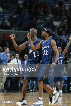 Guard Michael Jordan of the Washington Wizards and guard Richard Hamilton celebrate after Jordan hit the gamewinning shot at the end of the NBA game...