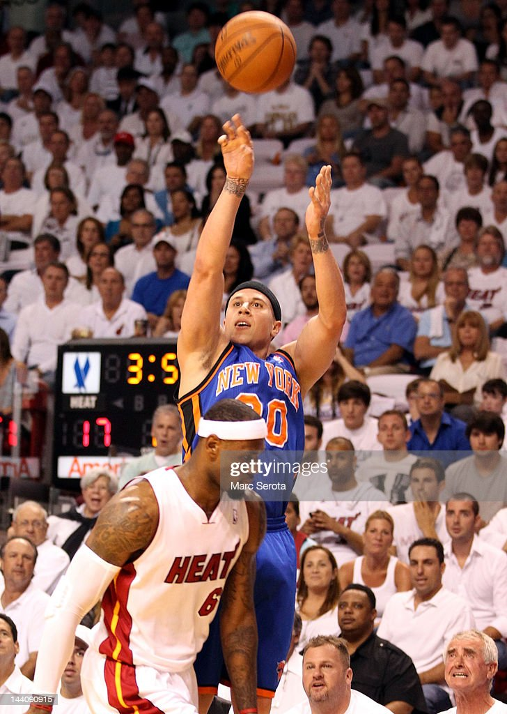 Guard Mike Bibby #20 of the New York Knicks shoots against Lebron James #6 of the Miami Heat in Game Five of the Eastern Conference Quarterfinals in the 2012 NBA Playoffs on May 9, 2012 at the American Airines Arena in Miami, Florida.