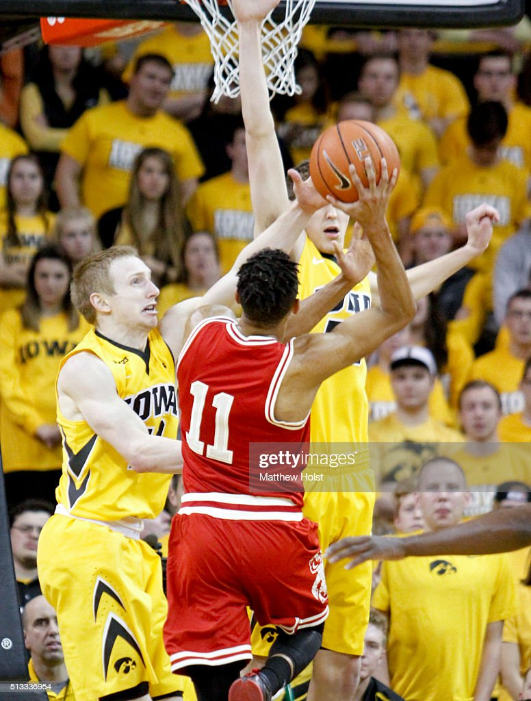 Guard Mike Gesell and forward Nicholas Baer the Iowa Hawkeyes defend against guard Jordan Hill of the Wisconsin Badgers in the second half on...
