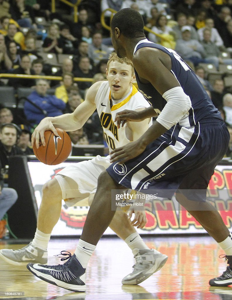 Guard Mike Gesell #10 of the Iowa Hawkeyes brings the ball down the court during the second half against forward Jon Graham #25 of the Penn State Nittany Lions on January 31, 2013 at Carver-Hawkeye Arena in Iowa City, Iowa. Iowa won 76-67.