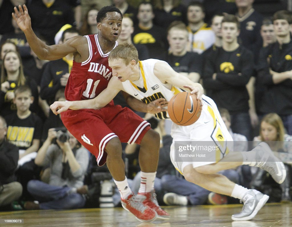 Guard Mike Gesell #10 of the Iowa Hawkeyes drives down the court during the first half against guard Kevin 'Yogi' Ferrell #11 of the Indiana Hoosiers on December 31, 2012 at Carver-Hawkeye Arena in Iowa City, Iowa. Indiana won 69-65.