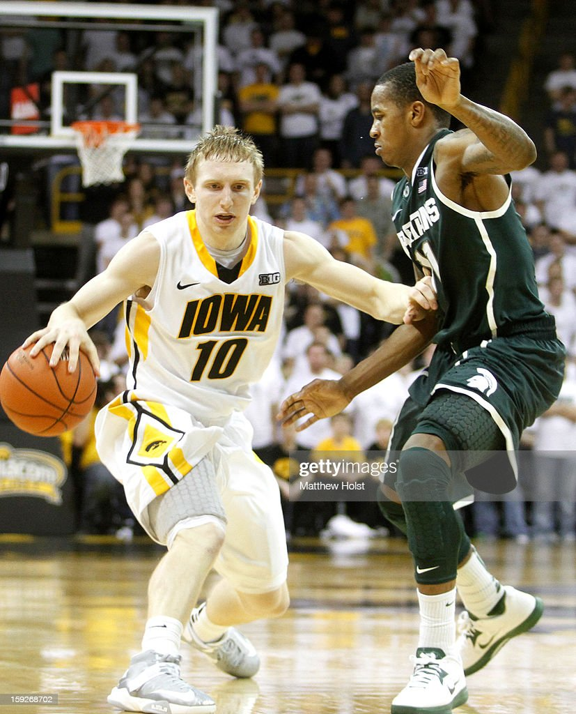 Guard Mike Gesell #10 of the Iowa Hawkeyes drives down the court during the second half against guard Keith Appling #11 of the Michigan State Spartans on January 10, 2013 at Carver-Hawkeye Arena in Iowa City, Iowa. Michigan State won 62-59.