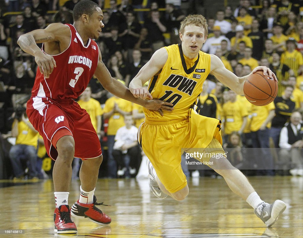 Guard Mike Gesell #10 of the Iowa Hawkeyes drives down the court during the second half against guard George Marshall #3 of the Wisconsin Badgers on January 19, 2013 at Carver-Hawkeye Arena in Iowa City, Iowa. Iowa won 70-66.