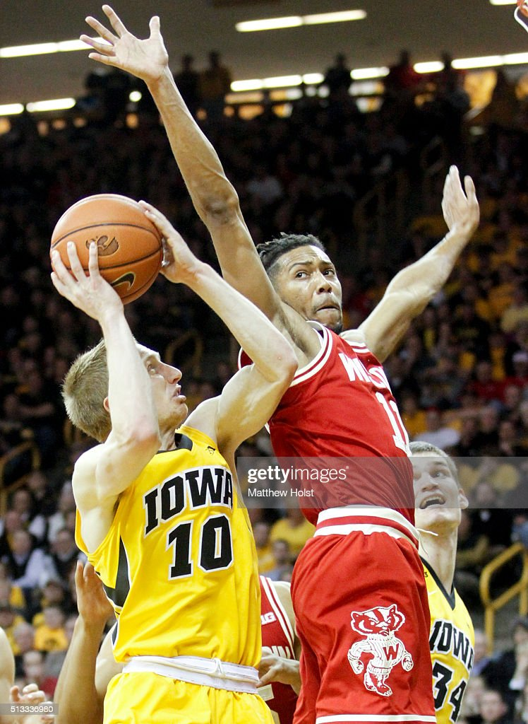 Guard Mike Gesell of the Iowa Hawkeyes goes to the basket against guard Jordan Hill of the Wisconsin Badgers in the second half on February 24 2016...