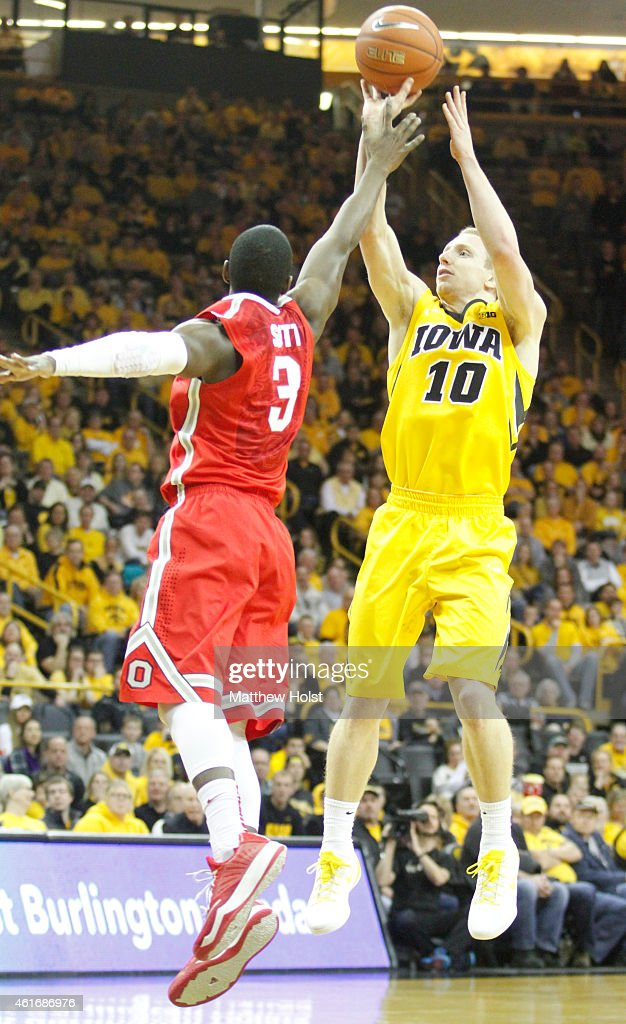 Guard Mike Gesell of the Iowa Hawkeyes guard Shannon Scott of the Ohio State Buckeye in the second half on January 17 2015 at CarverHawkeye Arena in...