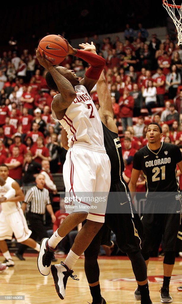 Guard Mike Ladd #2 of the Washington State Cougars attempts to score a goal against the Colorado Buffaloes during the game at Beasley Coliseum on January 19, 2013 in Pullman, Washington.