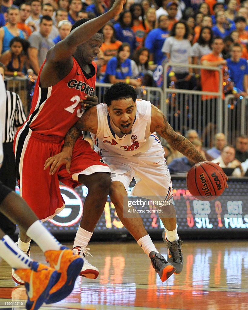 Guard Mike Rosario #3 of the Florida Gators drives up court against guard Sherrard Brantley #23 of the Georgia Bulldogs January 9, 2013 at Stephen C. O'Connell Center in Gainesville, Florida.