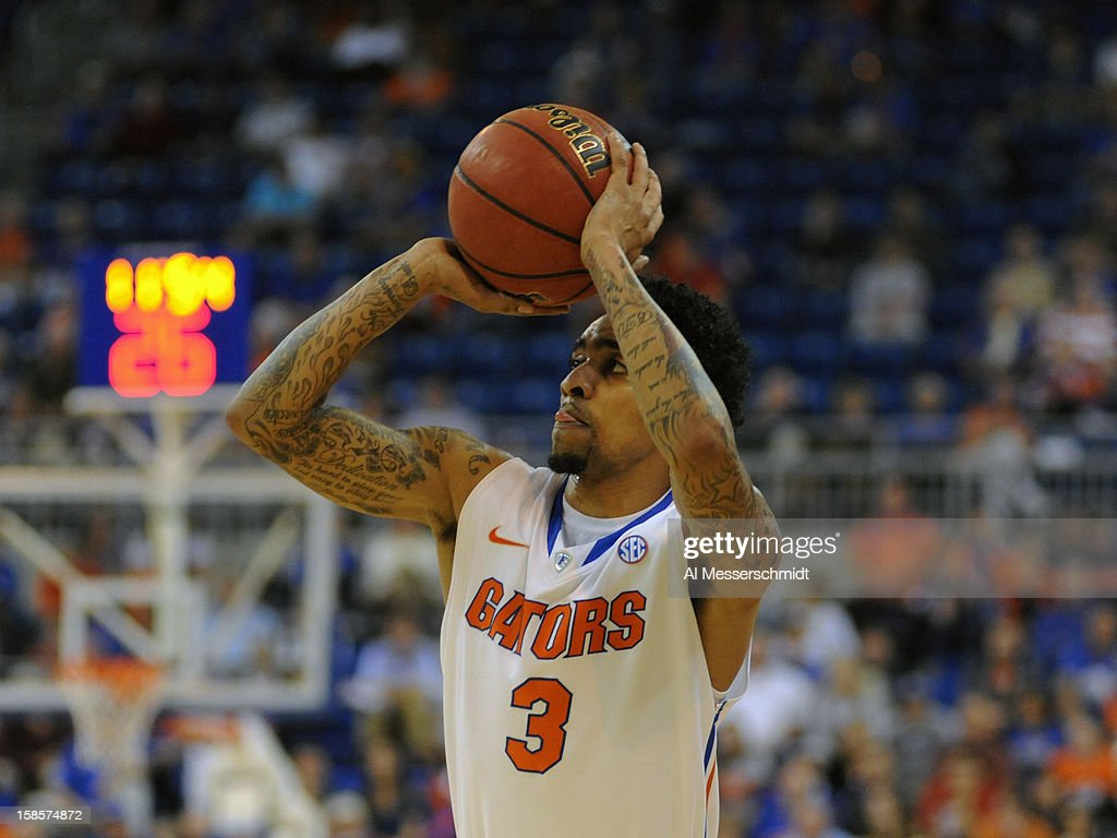 Guard Mike Rosario #3 of the Florida Gators shoots for three points against the Southeastern Louisiana Lions December 19, 2012 at Stephen C. O'Connell Center in Gainesville, Florida. The Gators won 82 - 43.