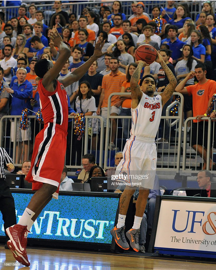 Guard Mike Rosario #3 of the Florida Gators shoots for three points against the Georgia Bulldogs January 9, 2013 at Stephen C. O'Connell Center in Gainesville, Florida. Florida won 77 - 44.