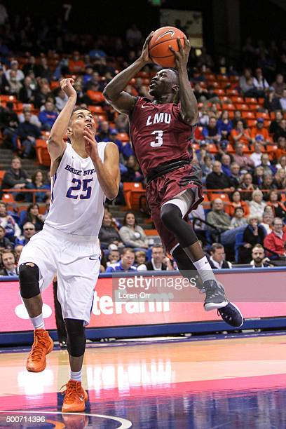 Guard Munis Tutu of the Loyola Marymount Lions drives to the hoop against the defense of guard Lonnie Jackson of the Boise State Broncos during...