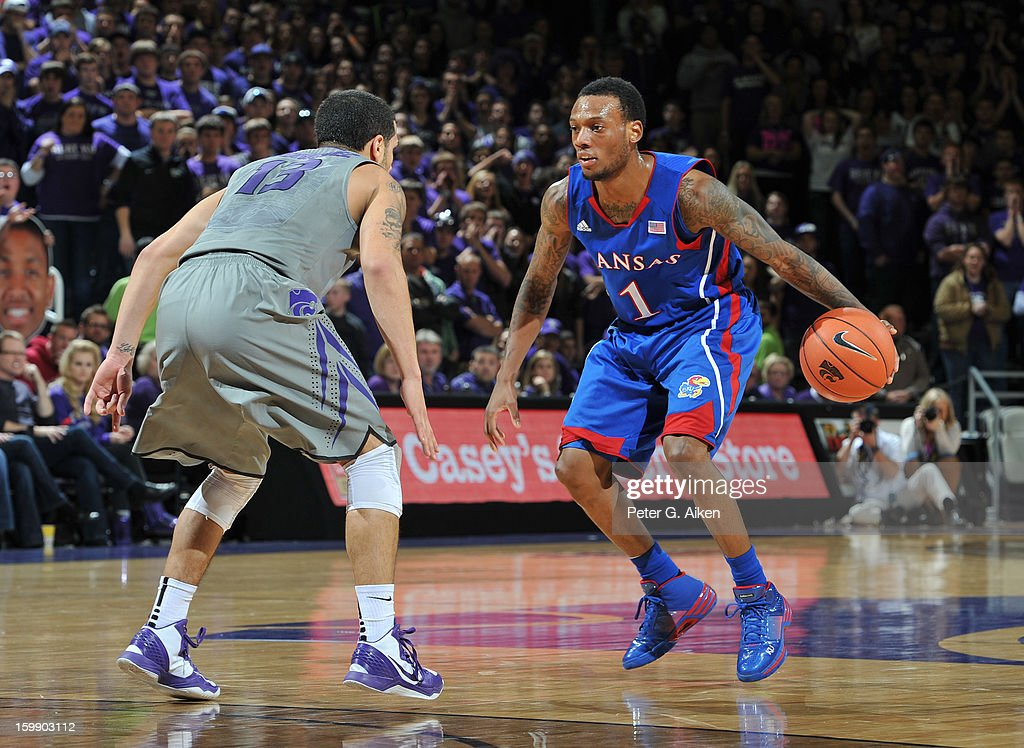 Guard Naadir Thorpe #1 of the Kansas Jayhawks brings the ball up court against guard Angel Rodriguez #13 of the Kansas State Wildcats during the first half on January 22, 2013 at Bramlage Coliseum in Manhattan, Kansas. Kansas defeated Kansas State 59-55.