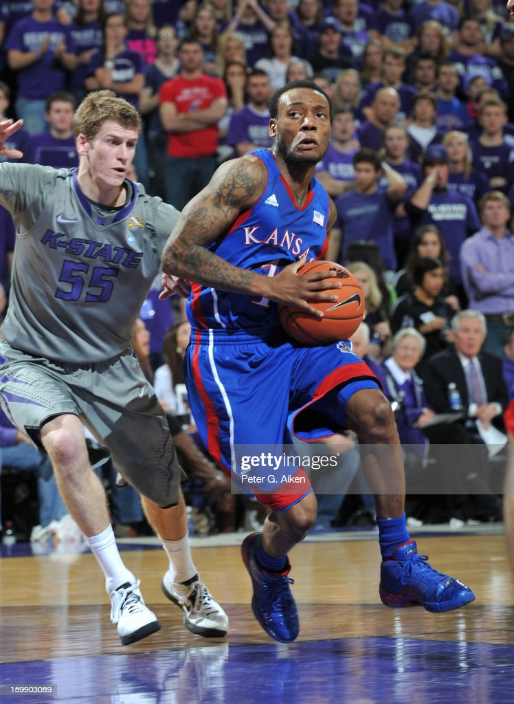 Guard Naadir Thorpe #1 of the Kansas Jayhawks drives past guard Will Spradling #55 of the Kansas State Wildcats during the first half on January 22, 2013 at Bramlage Coliseum in Manhattan, Kansas. Kansas defeated Kansas State 59-55.