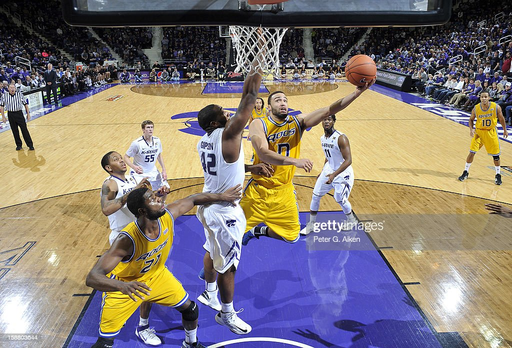 Guard Nate Rogers #0 of the Missouri-Kansas City Kangaroos drives to the basket against forward Thomas Gipson #42 of the Kansas State Wildcats during the second half on December 29, 2012 at Bramlage Coliseum in Manhattan, Kansas. Kansas State defeated Missouri-Kansas City 52-44.