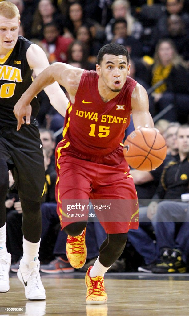 Guard Naz Long #15 of the Iowa State Cyclones brings the ball downt he court in front of forward <a gi-track='captionPersonalityLinkClicked' href=/galleries/search?phrase=Aaron+White+-+Basketball+Player&family=editorial&specificpeople=14619648 ng-click='$event.stopPropagation()'>Aaron White</a> #30 of the Iowa Hawkeyes, in the second half on December 12, 2014 at Carver-Hawkeye Arena, in Iowa City, Iowa.
