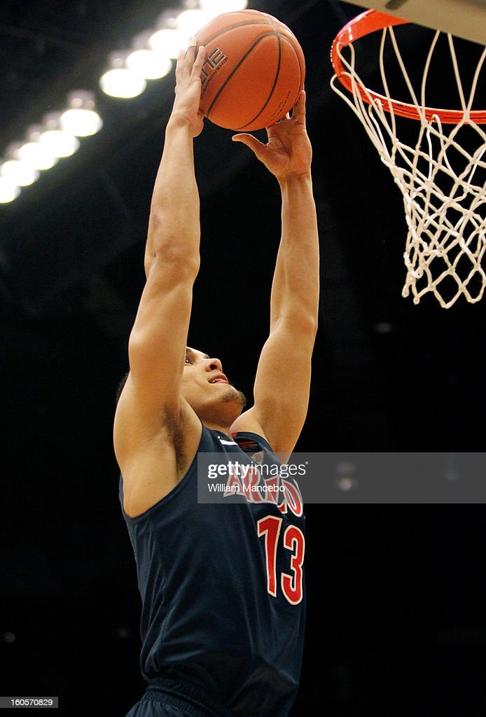 Guard Nick Johnson #13 of the Arizona Wildcats goes for the dunk against the Washington State Cougars during the second half of the game at Beasley Coliseum on February 2, 2013 in Pullman, Washington.