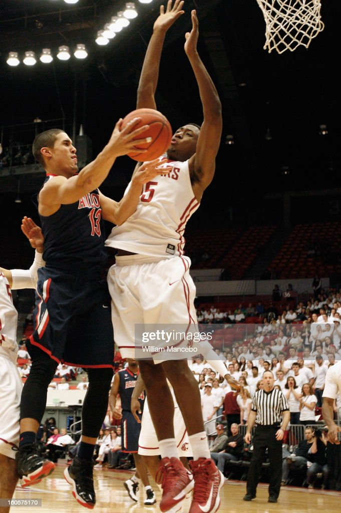 Guard Nick Johnson #13 of the Arizona Wildcats shoots against forward Junior Longrus #15 of the Washington State Cougars during the game at Beasley Coliseum on February 2, 2013 in Pullman, Washington.