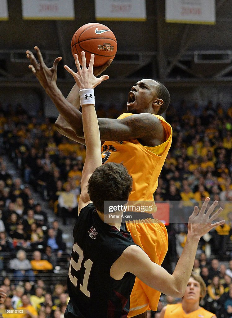 Guard Nick Wiggins #15 of the Wichita State Shockers puts up a shot against guard Tyler Smithpeters #21 of the Southern Illinois Salukis during the first half on February 11, 2014 at Charles Koch Arena in Wichita, Kansas.
