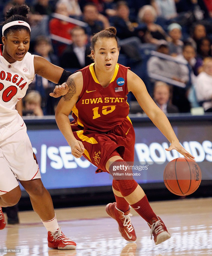 Guard Nicole 'Kidd' Blaskowsky #15 of the Iowa State Cyclones drives against guard/forward Shacobia Barbee#20 of the Georgia Lady Bulldogs during the second round of the 2013 NCAA Women's Basketball Tournament at McCarthey Athletic Center on March 25, 2013 in Spokane, Washington. The Lady Bulldogs defeated the Cyclones 65-60.