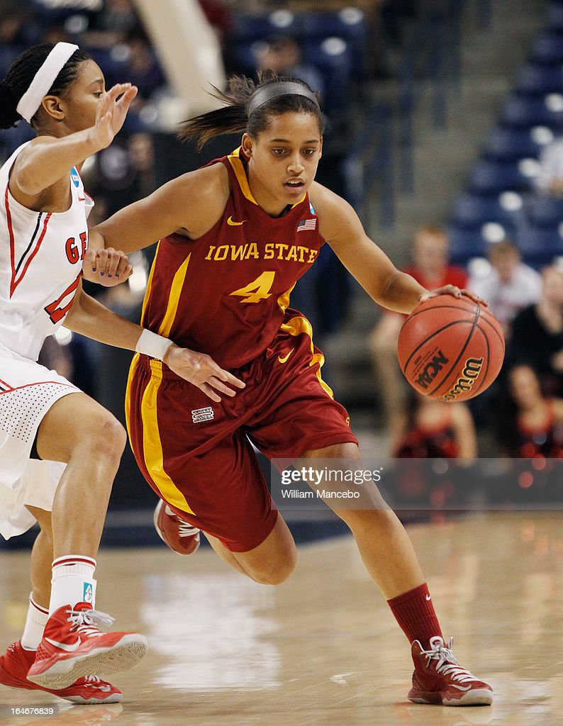 Guard Nikki Moody #4 of the Iowa State Cyclones drives against guard Tiaria Griffin #11 of the Georgia Lady Bulldogs during the second round of the 2013 NCAA Women's Basketball Tournament at McCarthey Athletic Center on March 25, 2013 in Spokane, Washington. The Lady Bulldogs defeated the Cyclones 65-60.